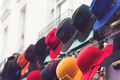 stand with colorful hats on store entrance - PhotoDune Item for Sale