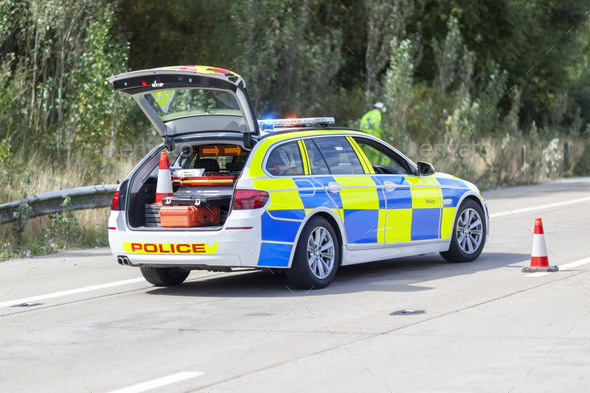 Police car at motorway accident or crime scene - Stock Photo - Images