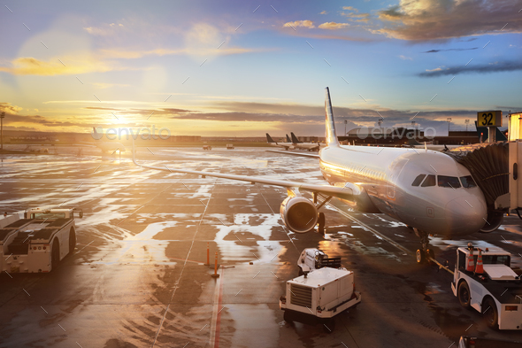 Airplane at terminal gate in international airport - Stock Photo - Images