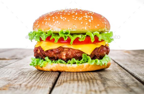 Tasty and appetizing hamburger cheeseburger - Stock Photo - Images