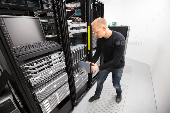 IT Technician Installing Blade Server In Chassis At Datacenter - Stock Photo - Images