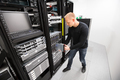 IT Technician Installing Blade Server In Chassis At Datacenter - PhotoDune Item for Sale