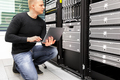 Consultant With Laptop Monitoring Servers In Datacenter - PhotoDune Item for Sale