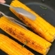 Turn the Cooked Corn Cobs in a Frying Pan - VideoHive Item for Sale