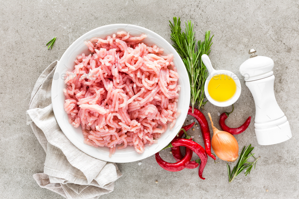 Mince. Ground meat with ingredients for cooking on light grey background. Top view - Stock Photo - Images