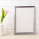 Silver frame mockup with tender soft pink tulip - PhotoDune Item for Sale