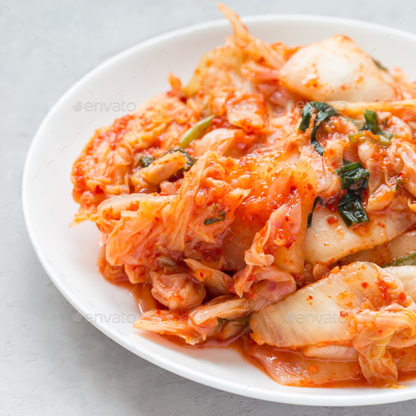 Kimchi cabbage. Korean appetizer on a white plate, square - Stock Photo - Images