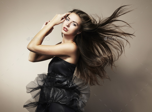 Portrait of young dancing woman with long flowing hair - Stock Photo - Images