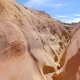 Camera Movement On A Dry Gorge With Smooth And Wavy Rocks Of The Red Canyon - VideoHive Item for Sale