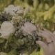 Woman Touches a Wedding Bouquet on a Sunny Day - VideoHive Item for Sale