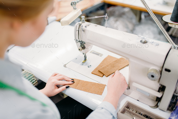 Dressmaker sews fabrics on a sewing machine - Stock Photo - Images