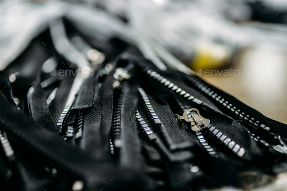 Zippers for clothes closeup, sewing industry - Stock Photo - Images
