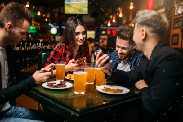 Fun friends in a sport bar, victory celebration - Stock Photo - Images