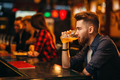 Man drinks beer at the bar counter in a sport pub - PhotoDune Item for Sale