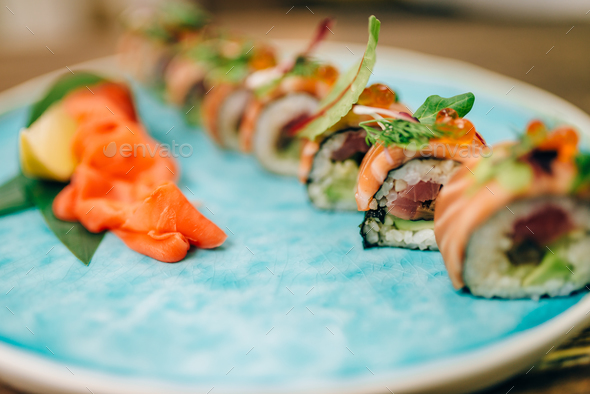 Sushi rolls with salmon fish on plate closeup - Stock Photo - Images