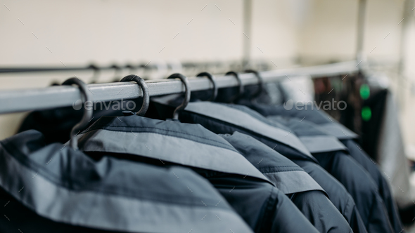 Clothes on hangers, sewing factory or dress fabric - Stock Photo - Images