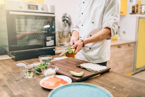 Sushi preparation process, japanese food - Stock Photo - Images