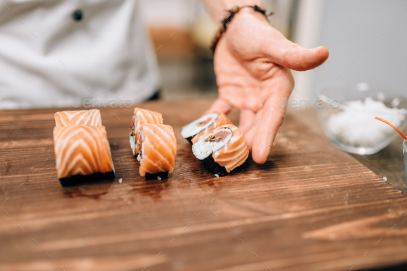 Male person cooking sushi, japanese kitchen - Stock Photo - Images