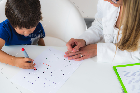 Child psychology, toddler doing logic tests with shapes - Stock Photo - Images