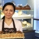 Mature Female Baker Posing at Her Store with a Basket Full of Croissants - VideoHive Item for Sale