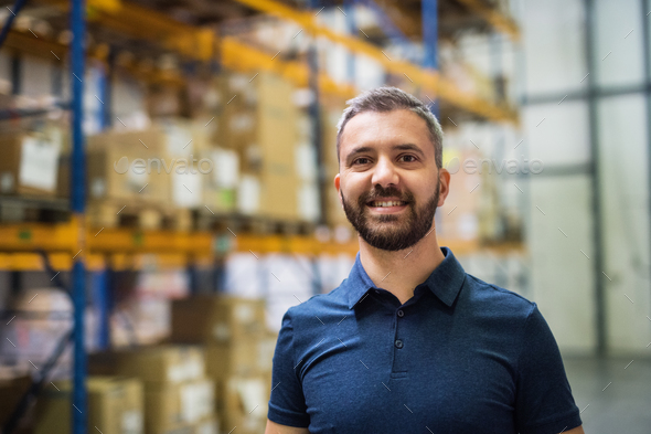 Portrait of a male warehouse worker. - Stock Photo - Images
