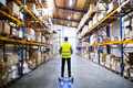 Male warehouse worker on hoverboard. - PhotoDune Item for Sale