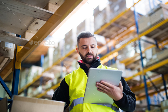 Male warehouse worker with tablet. - Stock Photo - Images