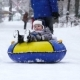 Boy of Two Years Rolling on Tubing in the Park in Winter - VideoHive Item for Sale