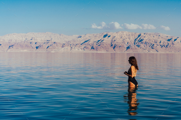 Young woman going to Dead Sea, Israel - Stock Photo - Images