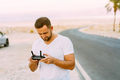 Guy controls drone with remote control - PhotoDune Item for Sale