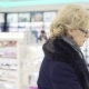A Middle-aged Woman Is Choosing Perfume in a Store - VideoHive Item for Sale