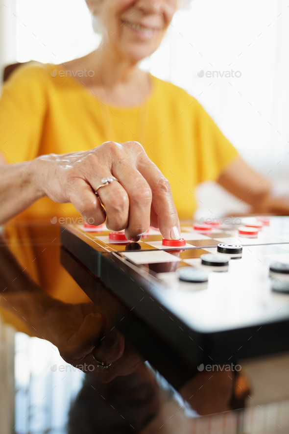 Grandma Playing Checkers Board Game In Hospice - Stock Photo - Images