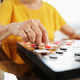 Grandma Playing Checkers Board Game In Hospice - PhotoDune Item for Sale