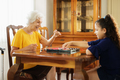Grandma Playing Checkers Board Game With Granddaughter At Home - PhotoDune Item for Sale