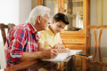 Little Boy Doing School Homework With Old Man At Home - PhotoDune Item for Sale