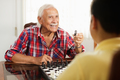 Grandpa Playing Chess Board Game With Grandson At Home - PhotoDune Item for Sale