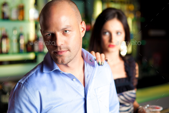 young man leaving bar - Stock Photo - Images