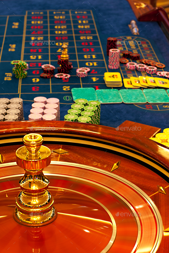 wooden roulette wheel spinning - Stock Photo - Images