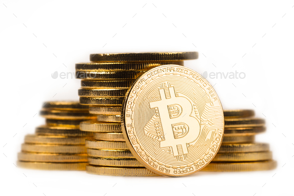 golden bitcoin in front of a pile of golden metallic coins on wh - Stock Photo - Images