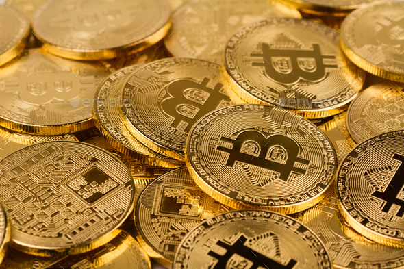 pile of golden bitcoins background texture - Stock Photo - Images