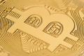 close up of on a golden coin bitcoin logo - PhotoDune Item for Sale