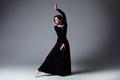 Slim ballerina in a black long dress - PhotoDune Item for Sale