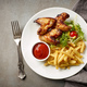 Plate of fried potatoes and chicken wings - PhotoDune Item for Sale