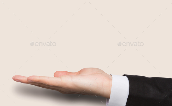 Outstretched male hand over pink background - Stock Photo - Images