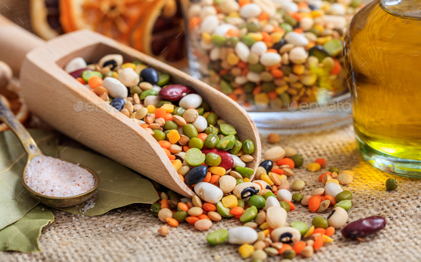 Wooden scoop and mixed raw legumes - Stock Photo - Images
