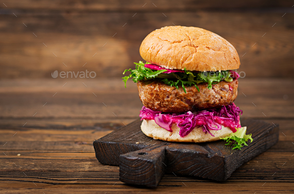 Sandwich hamburger with juicy burgers,  red cabbage and pink sauce - Stock Photo - Images