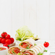 Tortilla wrap with ham, cheese and tomatoes on a white wooden background - PhotoDune Item for Sale
