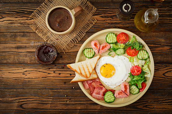 Breakfast on Valentine's Day - fried egg in the shape of a heart - Stock Photo - Images