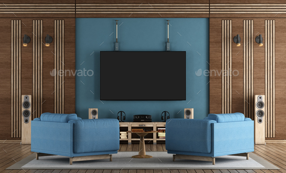 Home cinema room with TV hanging on blue wall - Stock Photo - Images