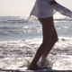 Feet of Woman in Bikini and Shirt Running on the Sea Waves at Sunrise. Young Beautiful Girl Jogging - VideoHive Item for Sale